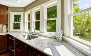 marble countertop in wood kitchen