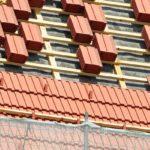 professional roofer installing tiles