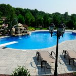 Swimming Pool with Diving Board and Waterfall