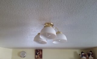 Popcorn ceiling with light