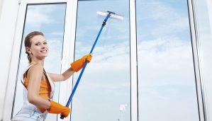 female window washer at work