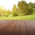 Wooden plank stage platform in a lush backyard