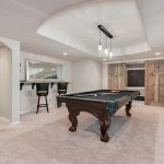 Finished basement remodel with pool table