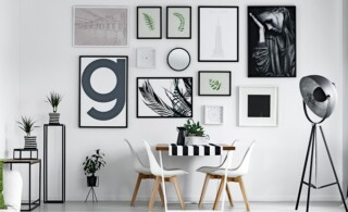 Scandi style dining hall with pictures on the wall