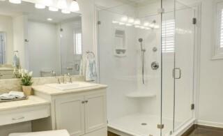 glass framed and fiberglass pan shower