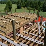 surrounding deck framing being constructed around the pool
