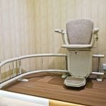 Stair lift on staircase for elderly people.