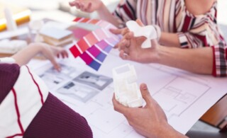 Creative famous interior designers feeling inspiration while looking at the apartment plan