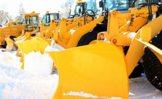 snow plows on standby for contracted customers
