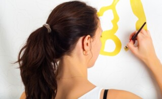 Woman painting her own wall