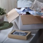 Woman in mourning packing remembrances after dead husband
