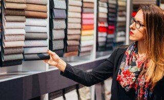 Professional Interior Designer Hired By Homeowner Looks at Fabric