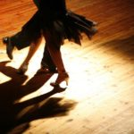 Tangoing couple alone on hardwood floor