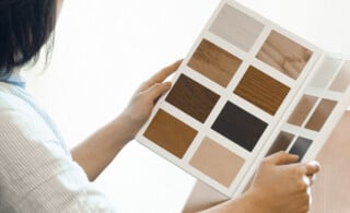 woman reviews types of flooring materials