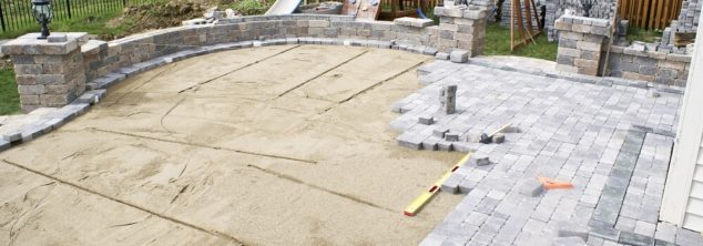 construction of a backyard paver patio