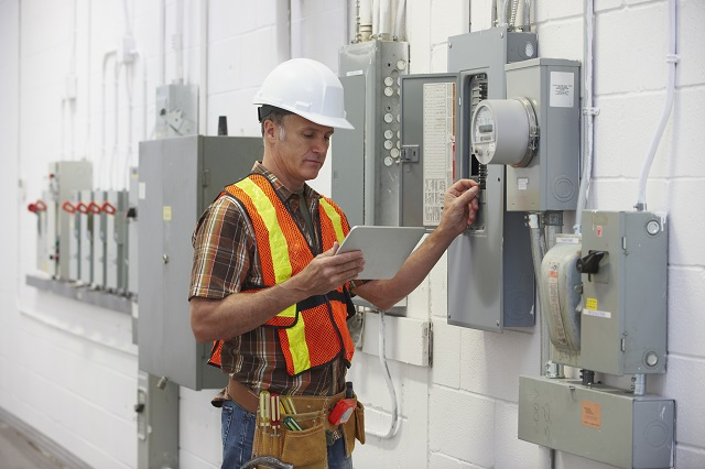 Electrician fixing a fuse