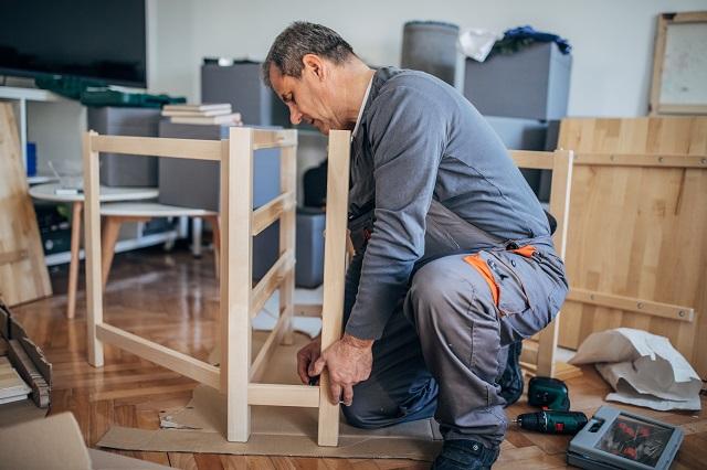 handyman assembling a wooden table