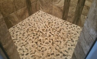 Modern shower with pebble flooring
