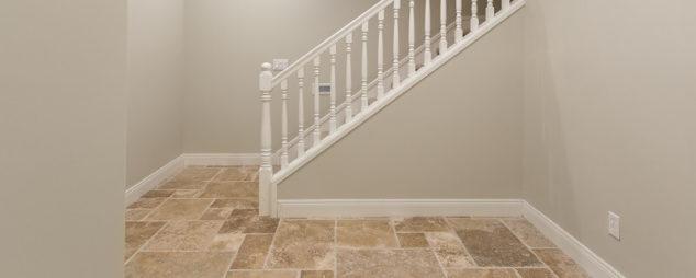 natural stone tiles on basement floor