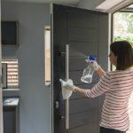 Woman cleaning front door