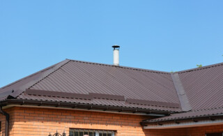 metal roof on brick house