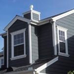 Suburban house with grey siding and white trim