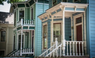 Colorful Victorian style homes with white and green painted trim