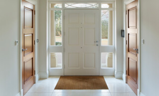 A front door entrance with tile flooring